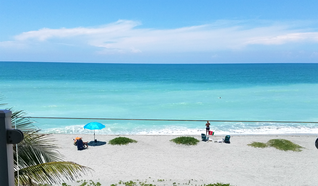 Siesta Key Gulf-front condo view - The unframed glass railing provides an unobstructed view from our Gulf-front Lanai.