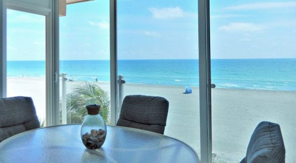 Siesta Key Gulf-front Lanai with Floor to Ceiling Sliding Doors - Million Dollar View