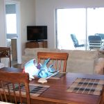 With the open floor plan you will enjoy a view of the Gulf from the Living Room, Dining Room and Kitchen
